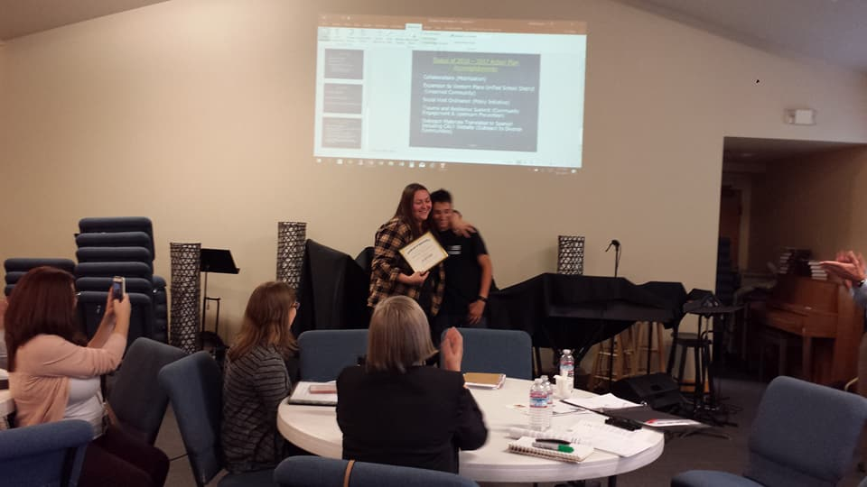 Kane Kelley presenting Melody Stockwell with her Certificate of Appreciation